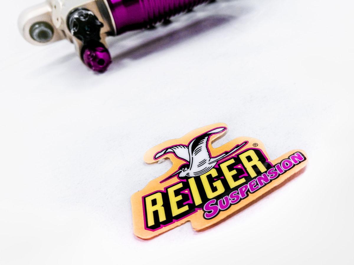 Sticker Left 70x50mm - Reiger Suspension